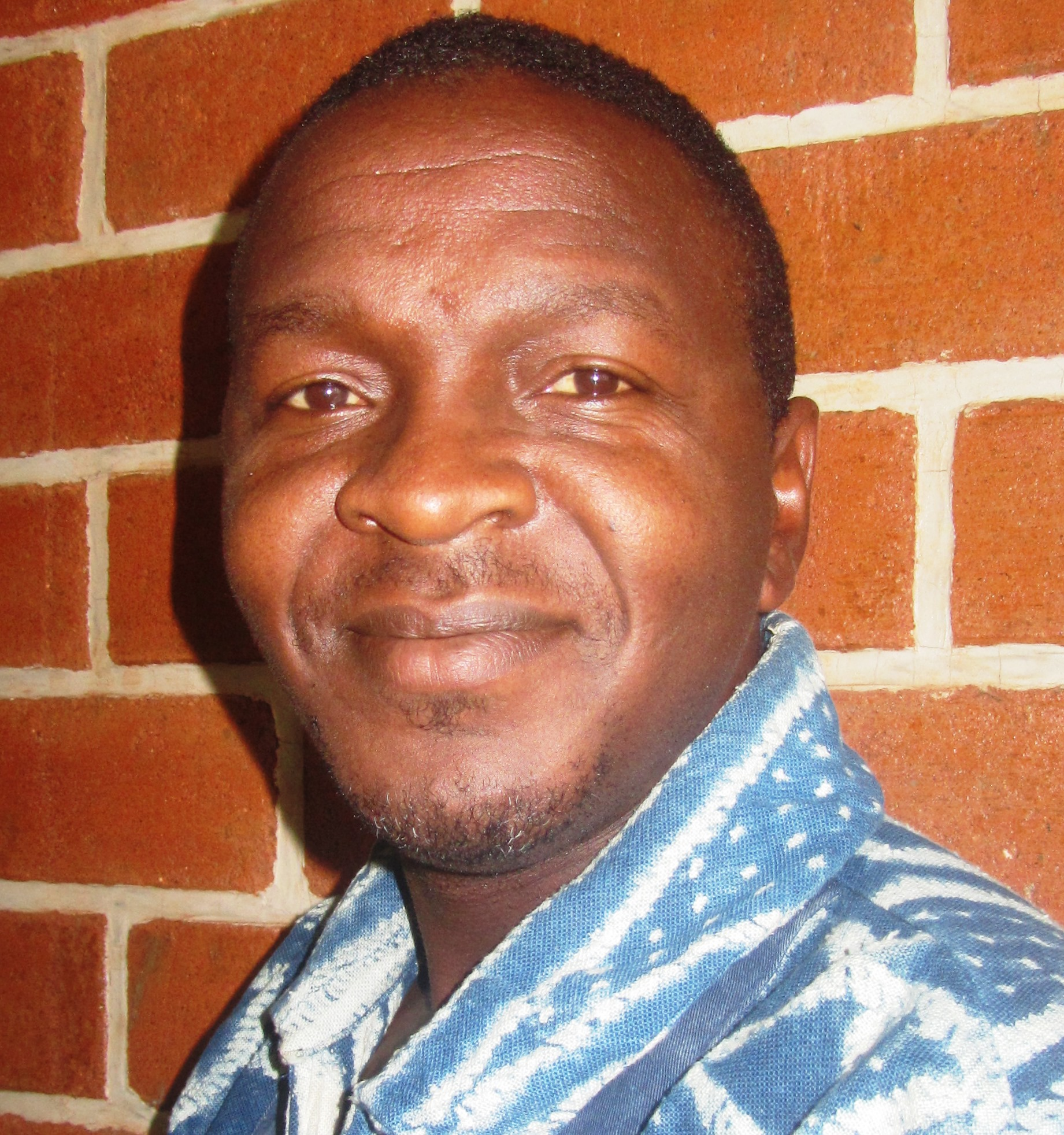Patrick Mbah, Okwen